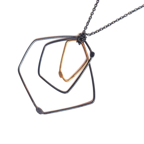 Gabrielle Desmarais single gold, double oxidized element necklace