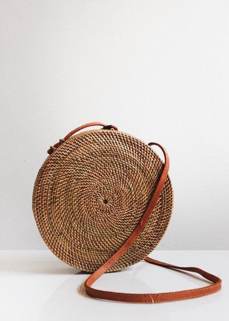 The Winding Road Woven Ata Grass Circle Bag - brown