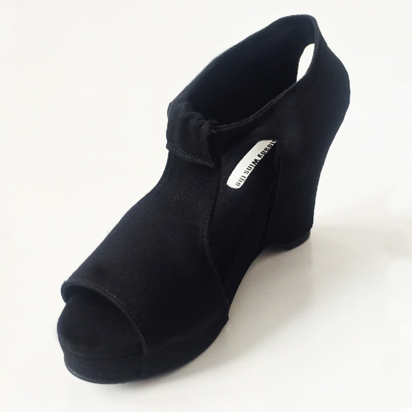 Slow and Steady Wins the Race Wedge Sandal in Black with White Stitching