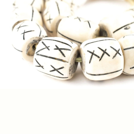 The Bead Chest Barrel X Bone Beads - Ivory/Black