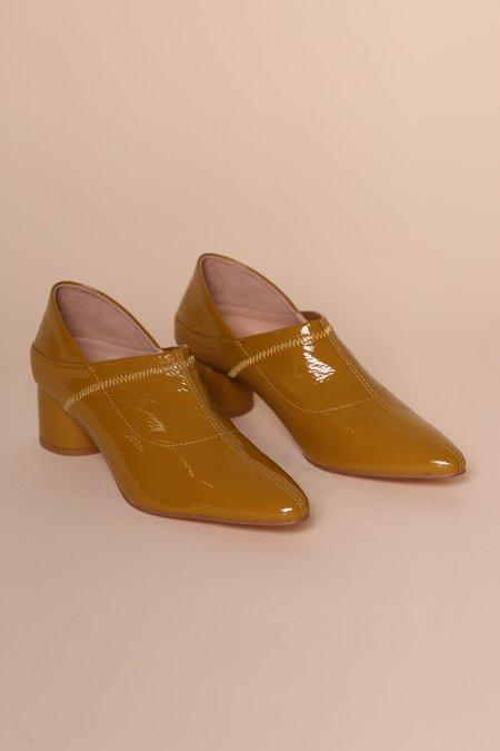 """INTENTIONALLY __________."" Walt Patent Heels"