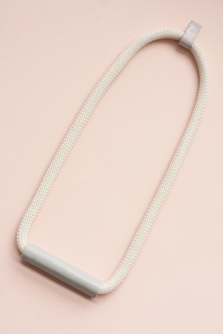 YYY Gray Tube Necklace On Cream Or Dark Gay Cord