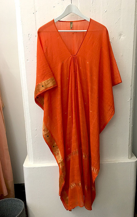 Two orange caftan with metallic border
