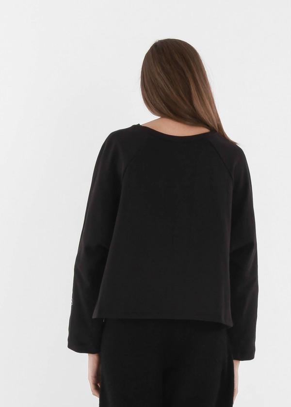 Kowtow Figurine Sweater